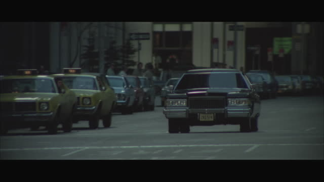 ws pan black sedan out of grand central station and past the waldorf astoria hotel / new york city, new york, usa - waldorf astoria stock videos and b-roll footage