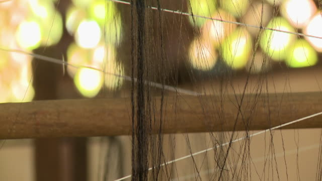 black silk thread on a traditional spinning wheels - ball of wool stock videos & royalty-free footage