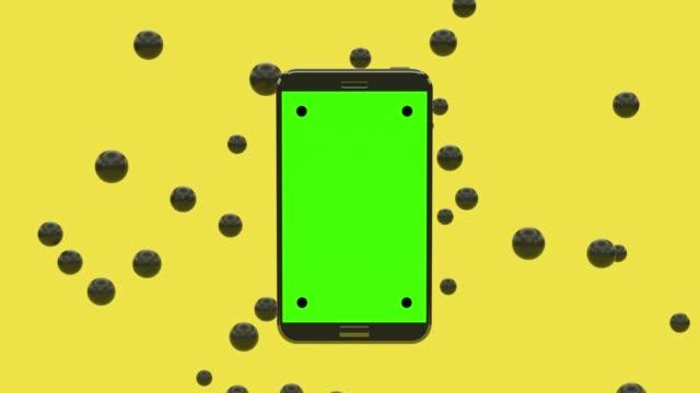 vidéos et rushes de noir smartphone vert écran sphère lévitation fond jaune - lévitation