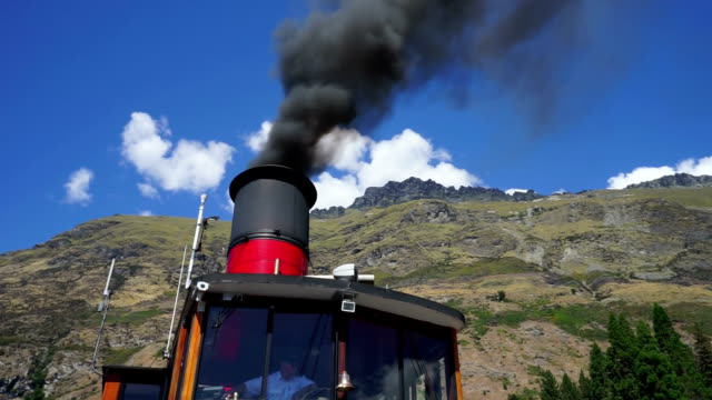 black smoke from chimney in blue sky - smoke stack stock videos and b-roll footage