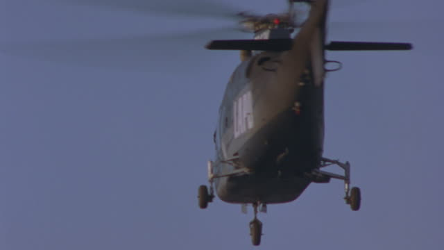 black smoke pours from under the rotors of a lapd helicopter which sends it in a tailspin. - helicopter stock videos and b-roll footage