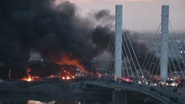 black smoke rises from burning tyres blocking the fahed bridge in nasiriyah as thousands of antigovernment demonstrators sought to shut streets... - nasiriyah stock videos & royalty-free footage