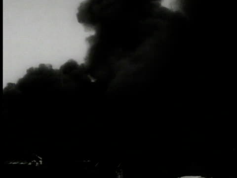 black smoke rising ha ws japanese soldiers firing cannons on road ws smoke signalman on dock waving flag signals to us navy ship in harbor vs smoke... - 1937 stock videos and b-roll footage