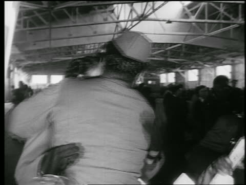 black soldier embraces black woman / end of wwii / educational - ホームカミング点の映像素材/bロール