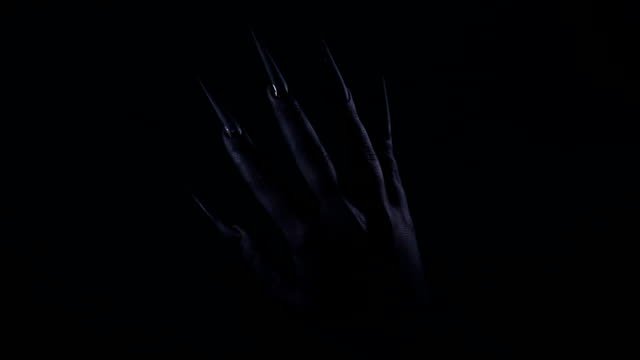 black spiky fingernails on black hand in the dark - witch stock videos & royalty-free footage