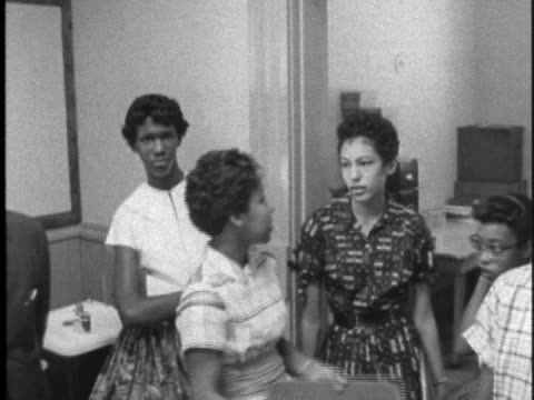 black students wait in a high school office to register for school. - アメリカ公民権運動点の映像素材/bロール