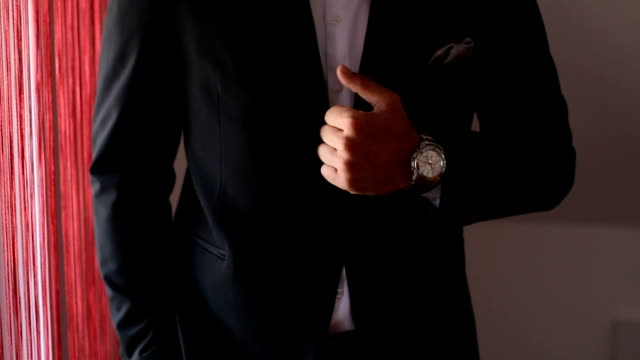 Black suit with tie and beautiful watch
