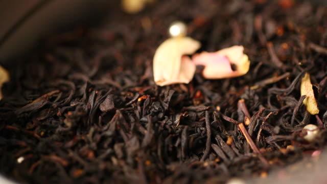 ecu black tea leaves falling / seoul, south korea - dried tea leaves stock videos & royalty-free footage
