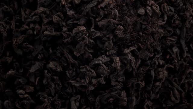 black tea leaves in the air - dried tea leaves stock videos & royalty-free footage