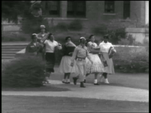 black teen students being escorted to school by national guard / arkansas - 1957 stock-videos und b-roll-filmmaterial