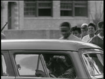 black teen students entering car / national guard standing behind them / newsreel - 1957 stock videos & royalty-free footage