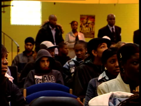 black teenagers targetted in awareness raising project itn london group of blck teenagers sitting watching police presentation on gun crime - gun crime stock videos & royalty-free footage