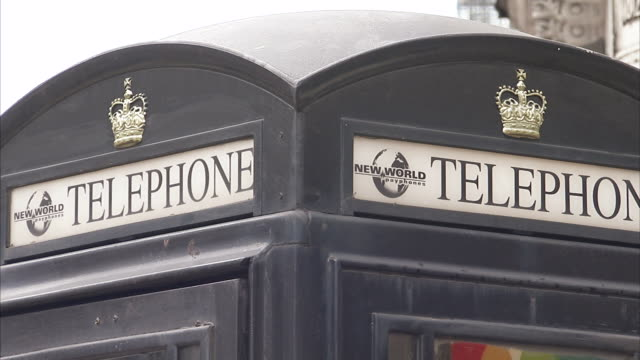 Black telephone box London Available in HD.