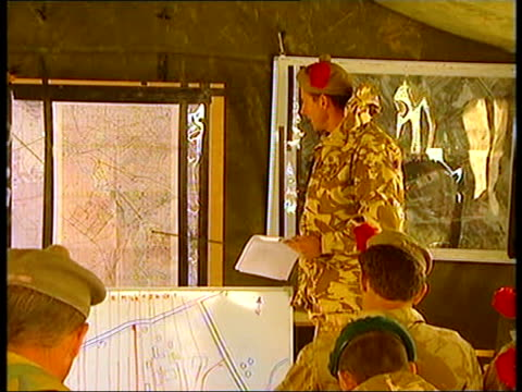 black watch operation against insurgents itn black watch officers attending briefing on the nights operations ms officers being briefed using model... - dogwood stock videos & royalty-free footage