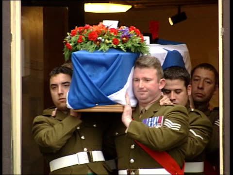 Black Watch soldier Scott McArdle buried ITN Fife Glenrothes Piper playing lament as out of church MS Coffin dressed in the Saltire of Black Watch...