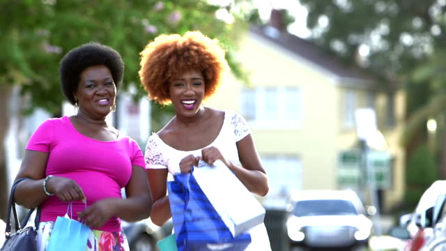 Black woman and her adult daughter shopping in the city