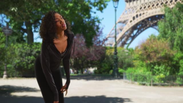 Black woman athlete in Paris taking a break to catch her breath