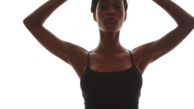 black woman dancing gracefully in slow motion - gympingdräkt bildbanksvideor och videomaterial från bakom kulisserna