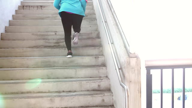 black woman exercising in city, running up stairs - steps stock videos & royalty-free footage