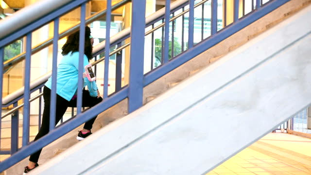 black woman exercising in city - african american culture stock videos & royalty-free footage