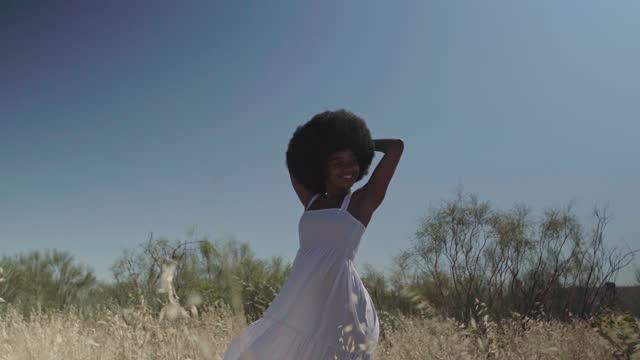 black woman relaxing in summer field - hands behind head stock videos & royalty-free footage