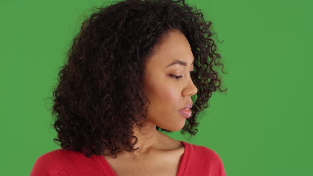 black woman thoughtfully looking off screen to the side on greenscreen - {{ contactusnotification.cta }} stock videos & royalty-free footage