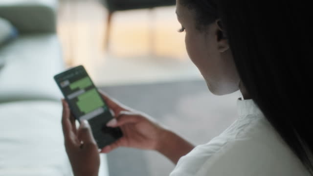 Black Woman Using Cell Phone For Internet Messaging App