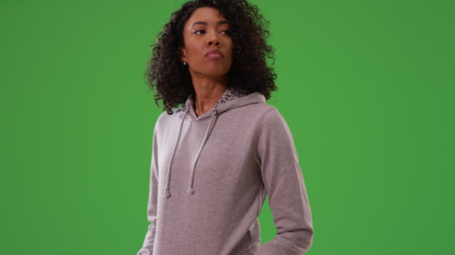 black woman waiting and looking around while dancing by herself on greenscreen - hooded top stock videos & royalty-free footage