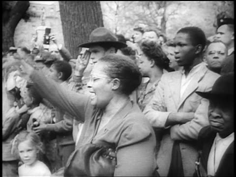 Black woman waves kerchief as other mourners look on at FDR's funeral / Washington DC