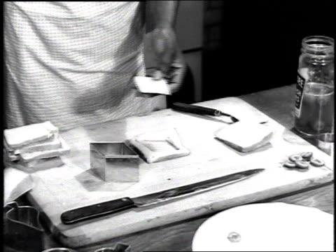 black women cooking / woman cutting diamond shapes in dough / woman making a salad / woman baking /