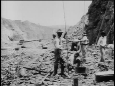 black workers on construction of panama canal / newsreel - 1906 stock-videos und b-roll-filmmaterial