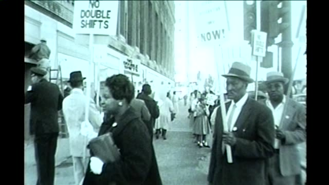 wgn black workers picketing in downtown chicago for better work regulations and no mandatory double shifts in october 1961 - black civil rights stock videos & royalty-free footage