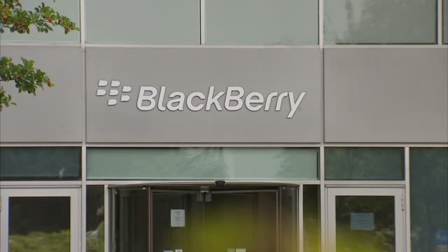 clean blackberry european headquarters in slough building exterior signs logo and branding canadian firm blackberry has announced it's to shed 4 and... - berkshire england stock-videos und b-roll-filmmaterial