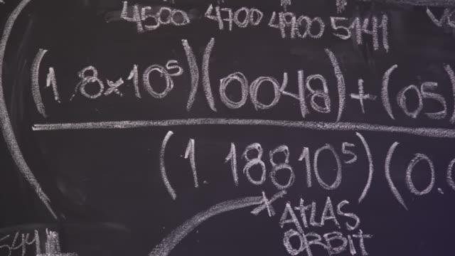 blackboard with math numbers - trigonometrie stock-videos und b-roll-filmmaterial