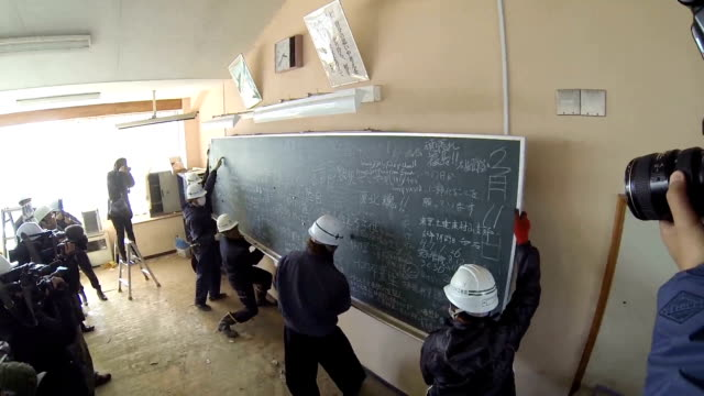 blackboards in classrooms of an abandoned school provided the perfect canvas for rescue workers to scribble messages to bolster the morale of... - scribble stock videos & royalty-free footage