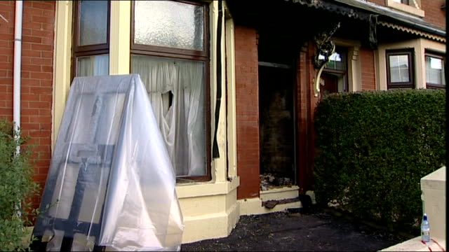 blackburn arson attack: four men found guilty; lib aftermath of arson attack showing burned out front window and door with letterbox - letterbox bildbanksvideor och videomaterial från bakom kulisserna