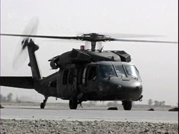 blackhawk military helicopter preparing to lift off at baghdad airport / baghdad, iraq / audio - 2007 stock videos & royalty-free footage