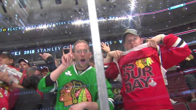 WGN Blackhawks Fans In The Stands After Stanley Cup Win on June 15 2015 in Chicago Illinois