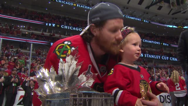 WGN Blackhawks Player On The Ice With His Young Son After Winning Stanley Cup on June 15 2015 in Chicago Illinois