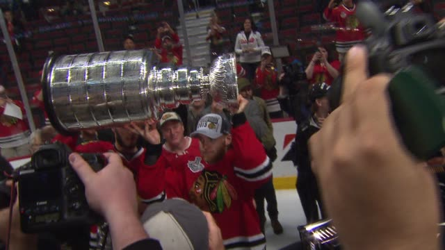 WGN Blackhawks Players On The Ice Pose With Stanley Cup on June 15 2015 in Chicago Illinois