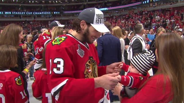 WGN Blackhawks Players On The Ice With Their Babies After Winning Stanley Cup on June 15 2015 in Chicago Illinois