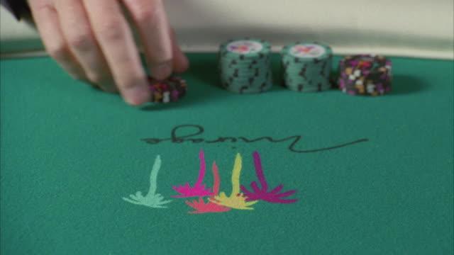 cu blackjack table, man bets two hundred dollars / las vegas, nevada, usa - western script stock videos & royalty-free footage