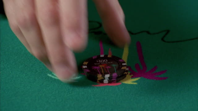 cu blackjack table, man bets two hundred dollars / las vegas, nevada, usa - gambling chip stock videos and b-roll footage