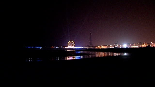 lancashire blackpool good shot illuminated blackpool tower big wheel and sea front and pier seen from beach - blackpool stock videos & royalty-free footage