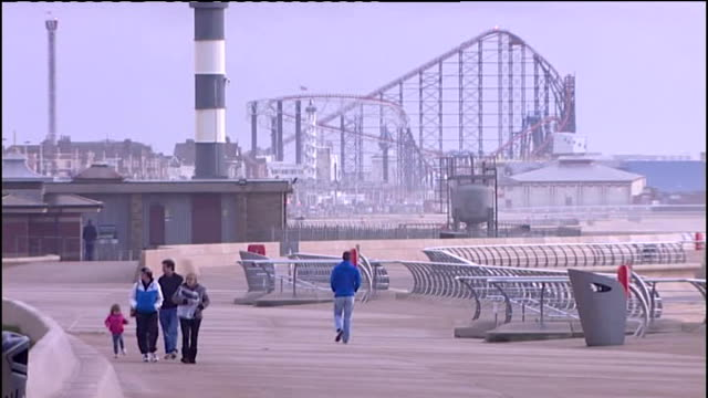 potential economic impact england lancashire blackpool ext general view of blackpool beach and pier pan shuttered amusement arcade general view of... - blackpool stock videos and b-roll footage