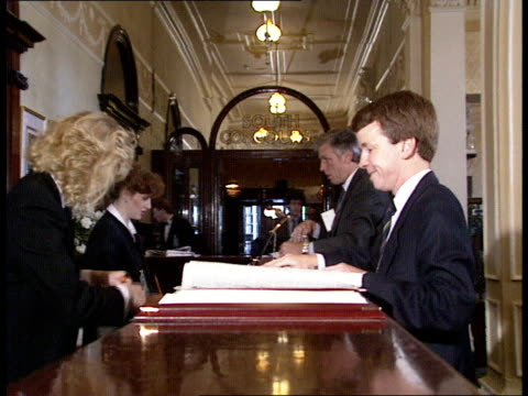 tory conference itn england / blackpool / int prime minister margaret thatcher down stairs with husband denis / applauded by fans / david waddington... - kenneth clarke stock-videos und b-roll-filmmaterial