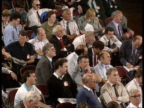 vídeos de stock e filmes b-roll de tuc conference tony blair labour mp sedgefield standing listening / ken gill msf chatting to delegates / gv delegates listening / gordon brown labour... - trades union congress