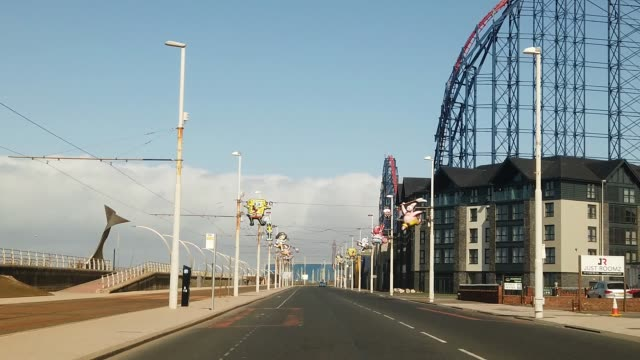 blackpool's golden mile near the amusement rides is deserted of holiday makers and locals as people and businesses observe the coronavirus pandemic... - drone stock videos & royalty-free footage