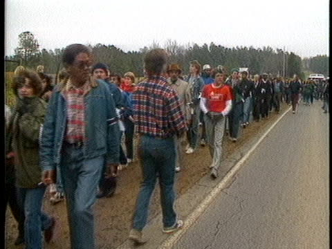blacks and whites march for brotherhood in forsyth county georgia as white protesterstaunt them. - protestor stock videos & royalty-free footage