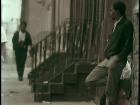 montage blacks hanging out in the ghetto / united states - philadelphia pennsylvania video stock e b–roll